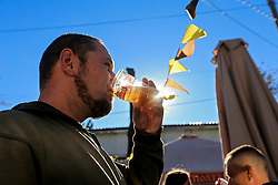 September 30, 2018 - Zaporizhzhia, Ukraine - A man drinks beer from a plastic cup as the sun shines through the beverage at the Beluga Beer Fest in Zaporizhzhia, southeastern Ukraine, September 30, 2018. Ukrinform. (Credit Image: © Dmytro Smolyenko/Ukrinform via ZUMA Wire)