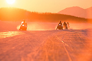 Alaska. Big Lake. Heading home at sunset after a winter weekend in the snow.