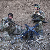 Captain Frank Reeves (left) a member of the Pathfinder platoon, part of 16 Air Assault Bde's elite BRF (Brigade Reconnaissance Force) gives a 'sitrep' (situation report) after his men and a specialist team called 'Brimstone' assault and occupy a compound to search for weapons and explosives as part of an operation in the Western Dasht, Helmand Province, Southern Afghanistan on the 20th of March 2011.