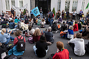 Climate justice is migrant justice protesters at an Extinction Rebellion demonstration gathering outside the Home Office in solidarity with migrants and those who suffer because of migration systems wordwide on 4th September 2020 in London, United Kingdom. With government resitting after summer recess, the climate action group has organised two weeks of events, protest and disruption across the capital. Extinction Rebellion is a climate change group started in 2018 and has gained a huge following of people committed to peaceful protests. These protests are highlighting that the government is not doing enough to avoid catastrophic climate change and to demand the government take radical action to save the planet.