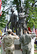 Middletown, N.Y.  -  Two soldiers salute in front of the monument for those who served in Iraq and Afghanistan during a Memorial Day ceremony  on May 25, 2009.