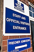 A sign for prisoner admissions and visitor / staff entrance. HMP/YOI Askham Grange is a women's open prison serving the Yorkshire area with a capacity of 128 women. It has extensive education, training and mother and Baby facilities.