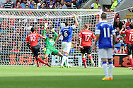 Everton keeper Tim Howard saves a close range shot from Cardiff's Fraizer Campbell (10). Barclays Premier league, Cardiff city v Everton at the Cardiff city Stadium in Cardiff,  South Wales on Saturday 31st August 2013. pic by Andrew Orchard,  Andrew Orchard sports photography,