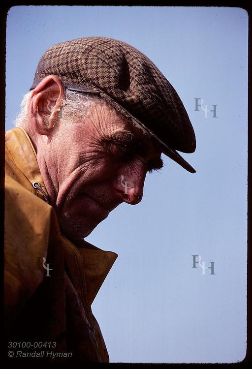 Head portrait of Icelandic fisherman in rain slicker; Reykjavik.*  Iceland