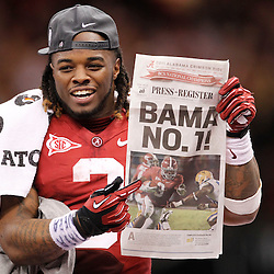 Jan 9, 2012; New Orleans, LA, USA; Alabama Crimson Tide running back Trent Richardson (3) holds the newspaper with a photo of himself after defeating the LSU Tigers 21-0 in the 2012 BCS National Championship game at the Mercedes-Benz Superdome.  Mandatory Credit: Derick E. Hingle-USA TODAY SPORTS