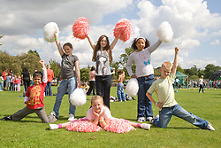 Group of children taking part in a cheerleading workshop at a Parklife summer activities event,