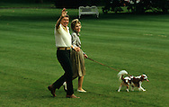 President Roanld Reagan and First Lady Nancy Reagan wave as they walk to Marine One in October 1986..Photograph by Dennis Brack bb30