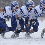 Darien linemen at the line of scrummage during the New Canaan Rams Vs Darien Blue Wave, CIAC Football Championship Class L Final at Boyle Stadium, Stamford. The New Canaan Rams won the match in snowy conditions 44-12. Stamford,  Connecticut, USA. 14th December 2013. Photo Tim Clayton