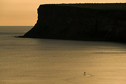 August 28, 2017 - Saltburn By The Sea, North Yorkshire, England - A paddle boarder goes for a morning paddle at sunrise on Bank Holiday Monday in Saltburn-by-the-Sea, North Yorkshire, England. (Credit Image: © Ian Forsyth/London News Pictures via ZUMA Wire)