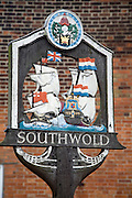Village sign showing ships engaged in the Battle of Sole bay, Southwold, Suffolk, England