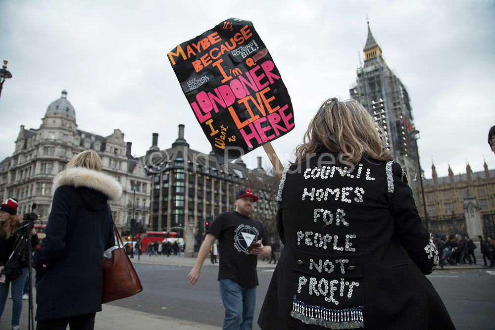 Demonstrator with a Pearly Kings and Queens jacket on protests around housing policy in Westminster on Budget Day on 22nd November 2017 in London, England, United Kingdom. As the Tories deliver their Autumn Budget, protesters make their views heard outside Parliament.