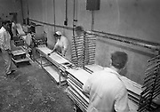 23/01/1963<br /> 01/23/1963<br /> 23 January 1963<br /> Interior of Liam Devlin and Son Ltd. factory at Cork Street, Dublin. Picture shows candy being cut into long strings for making sweet cigarettes.