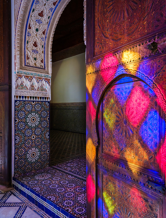 MARRAKESH, MOROCCO - CIRCA APRIL 2017: Window reflections on a door at the Bahia Palace in Marrakech