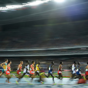 Long distance runners cirlcled the track at Olympic Stadium during the men's 10,000m final on Saturday at the Olympic Stadium during the 2016 Summer Olympics Games in Rio de Janeiro, Brazil.