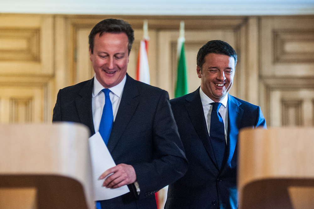 London, UK - 01 April 2014: Prime Minister of the United Kingdom, David Cameron (L), and Prime Minister of Italy, Matteo Renzi (R), arrive together at a joint press conference in Downing Street.