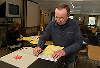 Sandra McGonagle and Larry Routhier go through the test ballots in the Accuvote voting machines at Gilford Town Hall in preparation for the upcoming Town Election on March 10th.  (Karen Bobotas/for the Laconia Daily Sun)