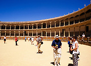 Tourists looking around the arena inside the bullring at Ronda, Andalucia, Spain