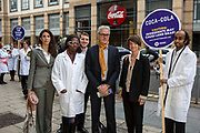 Oxfam supporters with Salvatore Gabola, Coca Cola's Public Affairs director for Europe outside its headquarters, calling for the company to tighten its supply chain so that the ingredients Coca Cola uses in its products are not grown on land that has been grabbed from poor communities