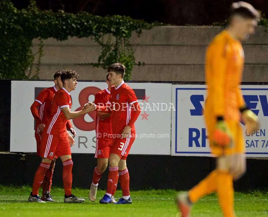 RHYL, WALES - Wednesday, November 14, 2018: Wales' Neco Williams celebrates scoring the first goal with Morgan Boyes during the UEFA Under-19 Championship 2019 Qualifying Group 4 match between Wales and Scotland at Belle Vue. (Pic by Paul Greenwood/Propaganda)