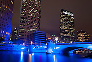 The bridge over the Hillsborough River on W Kennedy Blvd, lit up by a changing rotation of light, in Tampa, Florida.
