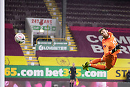 Burnley goalkeeper Will Norris (25) makes a save and watches the ball hitting the post during the FA Cup match between Burnley and Milton Keynes Dons at Turf Moor, Burnley, England on 9 January 2021.