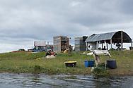 Rökning av lax vid en fiskestuga utanför Nome som ligger oskyddad för stormar och höjda vattennivåer.<br /> Numer måste de kontrollera extra noga så att insekter inte lägger ägg i laxen. <br /> Alaska, USA<br /> <br /> Fotograf: Christina Sjögren<br /> <br /> Photographer: Christina Sjogren<br /> Copyright 2018, All Rights Reserved