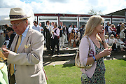 Chris Webber and Cindy Jackson. Cartier International Polo. Guards Polo Club. Windsor Great Park. 29 July 2007.  -DO NOT ARCHIVE-© Copyright Photograph by Dafydd Jones. 248 Clapham Rd. London SW9 0PZ. Tel 0207 820 0771. www.dafjones.com.