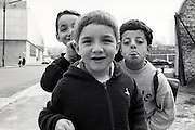 three boys interacting with the camera