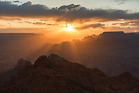 For most of the evening the sun hid behind clouds. But finally just before sunset, golden sunbeams emerged and flooded the canyon with light. I shot the sunset from Desert View, on the east side of the South Rim.
