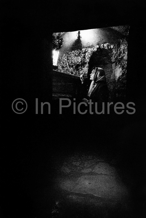 A pilgrim at Mary's Tomb on the Mount of Olives Jerusalem Israel