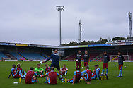 Scunthorpe United manager Neil Cox carrying out a team talk after the Pre-Season Friendly match between Scunthorpe United and Doncaster Rovers at Glanford Park, Scunthorpe, England on 15 August 2020.