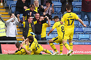 Ricky Holmes (12) of Oxford United scores a goal 3-1and celebrates during the EFL Sky Bet League 1 match between Oxford United and Burton Albion at the Kassam Stadium, Oxford, England on 25 August 2018.