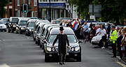 A pallbeare leads the cortege carrying British servicemen through the town of Wootton Bassett in western England, June 29, 2010. <br /> Pic: Paul Hackett