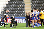 Hull FC hooker & captain Danny Houghton (9) pushes a boyin a wheelchair to the centre circle prior to the Betfred Super League match between Hull FC and St Helens RFC at Kingston Communications Stadium, Hull, United Kingdom on 16 February 2020.