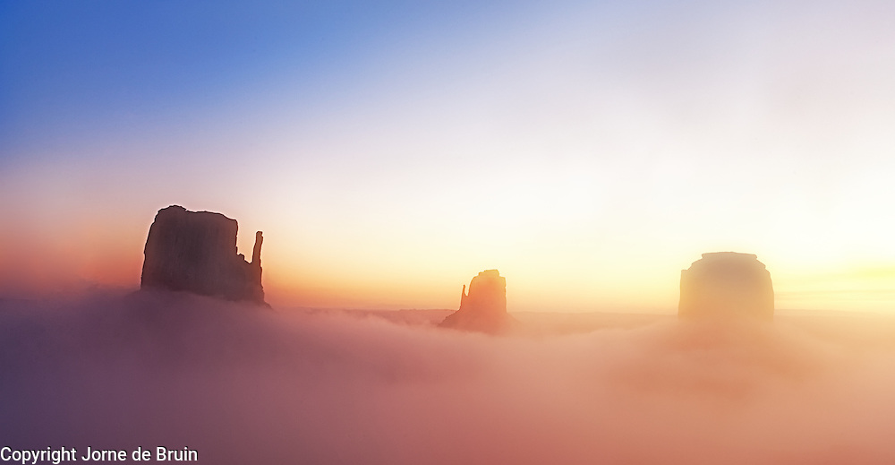 Monument Valley in early morning mist.