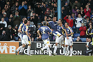 Cardiff city goalscorer Roger Johnson (12) gives a lift to teammate Wayne Routledge as Cardiff celebrate the opening goal scored by Johnson. Coca Cola championship, Cardiff city v Preston NE at Ninian Park on Sat 6th Dec 2008. pic by Andrew Orchard,Andrew Orchard sports photography