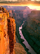 Sunrise light illumines the 3,000 ft. vertical wall of the Grand Canyon, at Toroweep viewpoint, above the Colorado River in Northern Arizona.