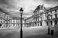 Visitors in the Cour Napoleon of the Louvre in Paris France.   Aspect Ratio 1w x 0.667
