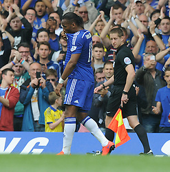 Chelsea's Didier Drogba kisses the chelsea badge as he comes off the field to be replaced by Chelsea's Diego Costa - Photo mandatory by-line: Alex James/JMP - Mobile: 07966 386802 - 24/05/2015 - SPORT - Football - London - Stamford Bridge - Chelsea v Sunderland - Barclays Premier League