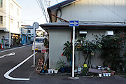 residential building with a shop on the ground floor and plants around Japan Yokosuka