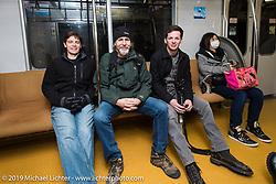 Charlie Wartgow, Michael Lichter and Ben McGinley on a Tokyo subway. Japan. Wednesday, December 10, 2014. Photograph ©2014 Michael Lichter.