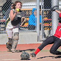 031814       Cable Hoover<br /> <br /> Grants Pirate Randee Romero (10) slides home as Thoreau Hawks catcher Dena Poe (30) fetches a wide pitch Tuesday at Ford Canyon Park.