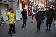 Members of Falun Gong or Falun Dafa meditating on Gerrard Street in central London, UK. Falun gong claim the following: On July 20, 1999, the Chinese Communist Party (CCP) launched the persecution against Falun Gong. Over the last nine years, 3,168 Falun Gong practitioners have lost their lives, many tortured to death; 75 of them were people in their eighties, and the youngest was only 8 months old. Thousands of practitioners are currently jailed and being tortured in forced labour camps, detention centres and prisons. The CCP even harvests organs from living Falun Gong practitioners for profit.