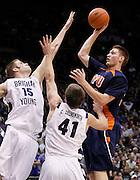 Fresno Pacific forward Jordan Wild, right, attempts to score over the defense of BYU center James Anderson (15) and forward Chris Collinsworth (41) during the second half of an NCAA college basketball game, Saturday, Jan. 1, 2011, in Provo, Utah. BYU defeated Fresno Pacific 93-57. (AP Photo/Colin E Braley)