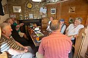 Men drinking scrumpy cider inside Tuckers Grave  pub, Faulkland, Somerset, England, UK