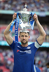 Chelsea's Gary Cahill celebrates with champagne after the game