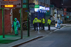 © Licensed to London News Pictures. 05/02/2020. London, UK. Officers inside a cordon as forensic investigators gather evidence after the Metropolitan Police Service was called to Kingsley Rd in Hounslow at 19:23GMT on Tuesday 4th Feb to reports of a fight. A 19-year-old man then self-presented at a hospital with stab injuries. One person has been arrested. Photo credit: Peter Manning/LNP
