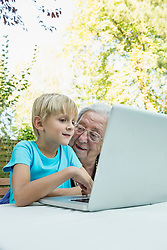 Grandmother and her grandson with laptop