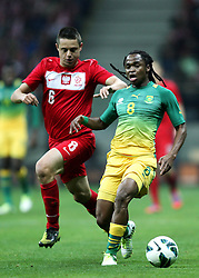 12.10.2012, Nationalstadion, Warschau, POL, FIFA WM Qualifikation, Polen vs Republik Sued Afrika, im Bild ARIEL BORYSIUK POL SIPHIWE TSHABALALA SA //, ARIEL BORYSIUK POL SIPHIWE TSHABALALA SA // during FIFA World Cup Qualifier Match between Poland and Republic South Africa at the National Stadium, Warsaw, Poland on 2012/10/12. EXPA Pictures © 2012, PhotoCredit: EXPA/ Newspix/ Michael Nowak..***** ATTENTION - for AUT, SLO, CRO, SRB, SUI and SWE only *****