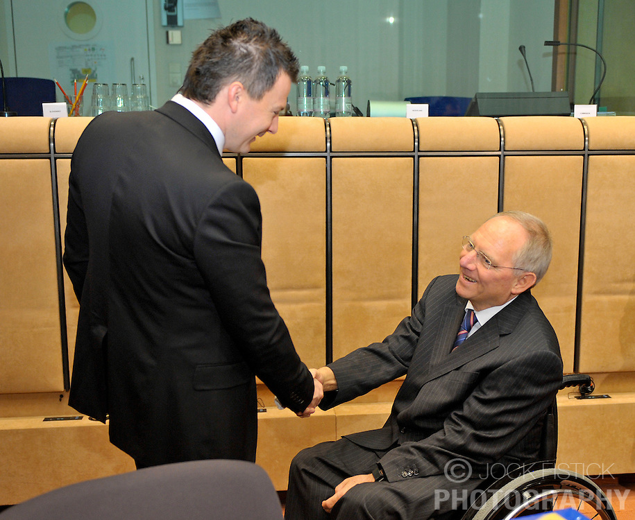 Jan Pociatek, Slovakia's finance minister, left, greets Wolfgang Schaeuble, Germany's finance minister, during Eurogroup, the meeting of finance ministers from the 16 euro-zone countries of the European Union, at the EU Council headquarters on Tuesday, Dec. 1, 2009, in Brussels, Belgium. Photographer: (Photo © Jock Fistick)